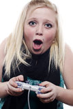 Young blonde girl playing video games Royalty Free Stock Photography