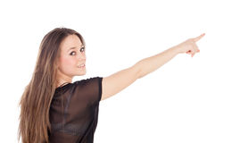Young blonde girl pointing with the finger Royalty Free Stock Photo