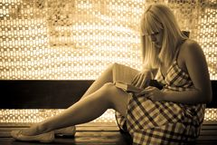 Young blonde girl reading royalty free stock image