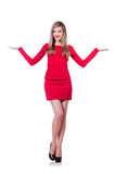 Young blonde girl in red short  dress holding Stock Photo