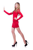 Young blonde girl in red short  dress pushing Stock Photography