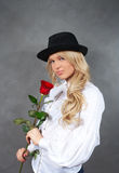 Young blonde girl with roses Stock Images