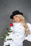 Young blonde girl with roses Stock Image