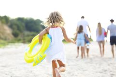 Young blonde girl running on the beech Stock Photo