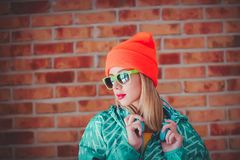Young blonde girl in 90s sports jacket royalty free stock photo