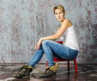 Young blonde girl with short hair in a denim jacket Royalty Free Stock Image