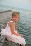 Young blonde girl sitting Royalty Free Stock Image