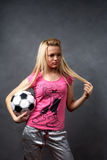 Young blonde girl with soccer ball Royalty Free Stock Photos