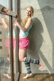 Young blonde girl in sports tank top and shorts Royalty Free Stock Images