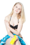 Young blonde girl with sunscreen lotion over white Stock Image