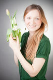 Young blonde girl with tulips Royalty Free Stock Image