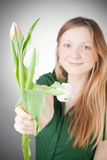 Young blonde girl with tulips Stock Images
