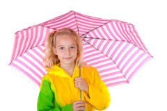 Young blonde girl under pink umbrella Stock Image