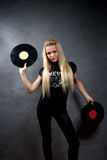 Young blonde girl with vinyl Royalty Free Stock Images