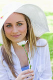 Young blonde girl wearing a white hat Stock Photography