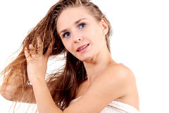 Young blonde girl with white towel Stock Images