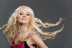 Young Blonde Girl With Flying Long Hair Stock Photography