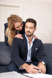 Young blonde gold digger woman with rich boss Stock Photos