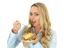 Young Blonde Haired Woman Eating a Hot Baked Jacket Potato with Cheddar Cheese Stock Photography