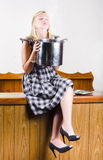 Woman holding hot cooking pot in kitchen Royalty Free Stock Photos