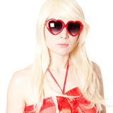 Young blonde in heart-shaped glasses Royalty Free Stock Photo
