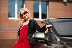 Happy young woman with a new car. Happy young blonde with a convertible car Stock Photo