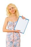 A young blonde holding paperclip Royalty Free Stock Photography