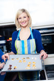 Young blonde Housewive baking Cookies Stock Photography