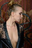 Young Blonde In A Black Negligee Royalty Free Stock Images
