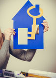 Young blonde lady holding symbols. Stock Images