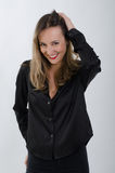 Young blonde  lady laughing. Young blonde lady laughing dressed in black shirt Stock Photography