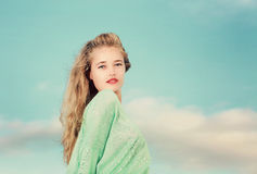 Young Blonde lady looking over her shoulder Royalty Free Stock Image