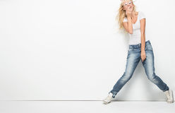 Young blonde lady smiling. Young blonde lady in casual clothes Stock Photography