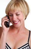 Young Blonde Lady using phone Stock Photography