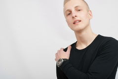 Young blonde man portrait in studio on gray background Stock Images