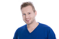 Young blonde man with stubble in blue top looking at camera isol Royalty Free Stock Images