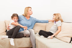 Young blonde mother having fun with her daughters Royalty Free Stock Photography