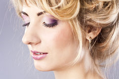 Young blonde with nice make-up, in the studio Stock Images