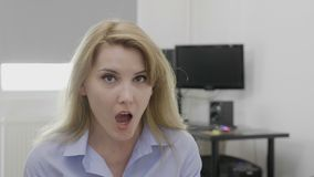 Free Young Blonde Office Woman At Work Saying Omg Oh My God Reaction With Astonished Face And Opened Mouth - Stock Photo - 120098860