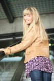 Young Blonde On An Escalator Royalty Free Stock Photography