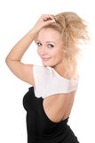 Young blonde playing with her hair Royalty Free Stock Image