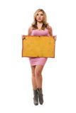 Young blonde posing with yellow board Royalty Free Stock Photos