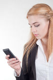 Young blonde pretty woman with smartphone Stock Photography