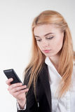 Young blonde pretty woman with smartphone Stock Photos