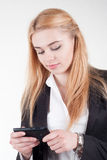 Young blonde pretty woman with smartphone Royalty Free Stock Photos