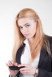 Young blonde pretty woman with smartphone Royalty Free Stock Photo
