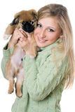 Young blonde with a puppy Stock Images