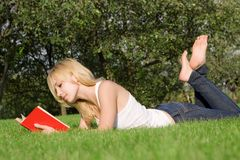Young Blonde Reads Book Stock Image