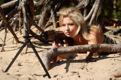 Young blonde with a rifle Royalty Free Stock Image