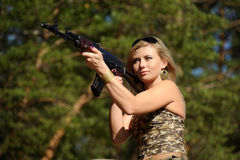 Young blonde with a rifle Stock Photography